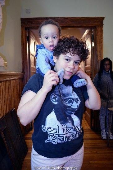 Analise, spoken word artist with her child at DDTM4!
